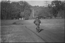 TL1947 : Cyclist on Biggleswade Common by John Winder