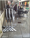 SX9292 : Nested folding tables outside one of Exeter's coffee shops, in the rain by Robin Stott