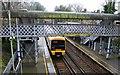 TQ4070 : Train and footbridge at Sundridge Park Station by David Martin