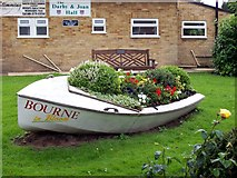 TF0920 : A boat full of flowers at Bourne, Lincolnshire by Rex Needle