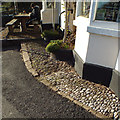 SX9575 : Pebbles as paving, Castle Inn, Holcombe by Robin Stott