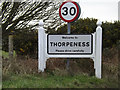 TM4660 : Thorpeness Village Name sign by Adrian Cable