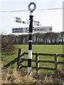 NU1633 : Fingerpost sign at Glororum by Graham Robson