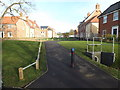 TM3863 : Fromus Walk at the Abbotts Grange Housing Estate by Adrian Cable