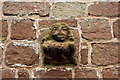 SJ4350 : Carved figure on the side of St Edith's Church by Jeff Buck
