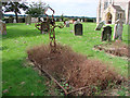 TG3225 : Unusual metal cross in Dilham churchyard by Adrian S Pye