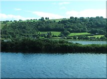 J1022 : View across the Newry Canal and Newry River towards the junction of Aghnamoira Road and the A2 by Eric Jones