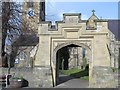 NY9864 : Arched entrance to the churchyard of St. Andrew's Church by Mike Quinn