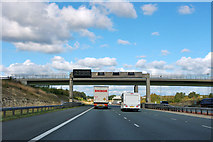SE4625 : Sign gantry and bridge over A1(M) by Robin Webster