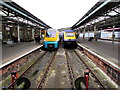 SS6593 : Two trains at the end of the line in Swansea station by Jaggery