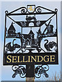 TR1038 : Sellinge village sign by Oast House Archive