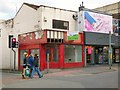SJ8990 : Jake Shoes and former charity shop by Gerald England