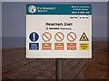 TF6534 : Heacham Dam warning sign by John Lucas