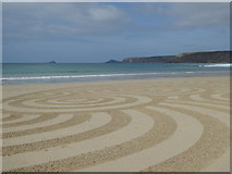 SW3526 : Sand art on the beach at Sennen Cove by Rod Allday