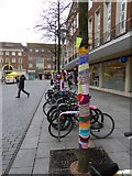 SX9292 : Cycle racks in Bedford Street, Exeter with yarnbombing by David Smith