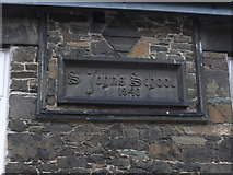 NY2623 : St John's Street: datestone on the old school by Basher Eyre