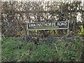 TG2001 : Swainsthorpe Road sign by Adrian Cable