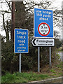 TM0667 : Roadsigns on Pound Hill by Adrian Cable