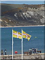 SZ0379 : Swanage: two Dorset flags fly by Chris Downer