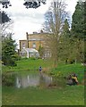 TQ3499 : Cleaning the lake, Myddelton House and Gardens by Julian Osley