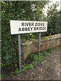 TM1573 : River Dove Abbey Bridge sign by Adrian Cable