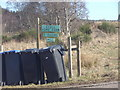 NJ5001 : Sign post with bins by Stanley Howe