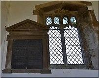SK8707 : Egleton: St. Edmund's Church: Memorial echoing the window next to it by Michael Garlick