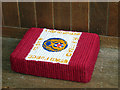 TM1389 : Tibenham All Saints' church  - kneeler by Evelyn Simak