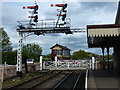 TL0997 : Signals and level crossing at Wansford Station by Richard Humphrey