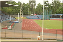 TQ3470 : View of the athletics track from the walkway into the National Sports Centre #2 by Robert Lamb