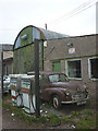 NY5922 : Old fuel pumps and Morris Minor, Halmshaw Garage, Morland by Karl and Ali