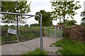 SJ7856 : Alsager: path and metal kissing gate by Jonathan Hutchins