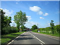 SP0549 : B4088 Approaching Harvington Village Sign & 30mph Limit by Roy Hughes