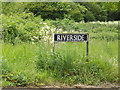TM1179 : Riverside sign by Adrian Cable