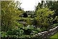 SW9273 : Ornamental pond at Tregonce by John Myers