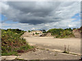 TM1374 : Rubble stored on the NW/SE runway by Evelyn Simak