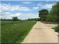 TM1476 : Concreted track by Church Farm by Evelyn Simak