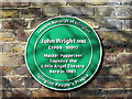 Photo of John Wright green plaque