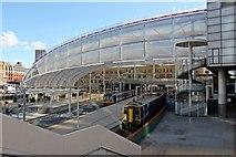 SJ8499 : Northern Rail units, Manchester Victoria railway station by El Pollock