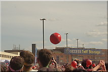 TQ1985 : View of a giant volleyball in the crowd at the Colour Run by Robert Lamb