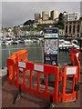 SX9163 : Cordoned-off information board, Torquay harbour by Derek Harper