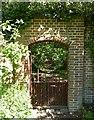 SU8403 : Rymans - Gate into woodland by Rob Farrow