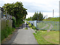 NZ3657 : Cycle path alongside the South Hylton extension of the Tyne and Wear Metro by Oliver Dixon