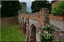 TL7835 : Castle Hedingham: The bridge over the dry moat and the Norman keep beyond by Michael Garlick