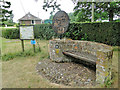TM1496 : Seat, information board and village sign at Fundenhall by Adrian S Pye