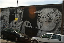 TQ3783 : View of a wall of street art on Bream Street by Robert Lamb