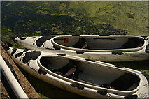 TQ3784 : View of a pair of canoes by the River Lea towpath by Robert Lamb