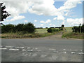 TF8326 : Farm track and footpath across Station Road at Rudham by Adrian S Pye