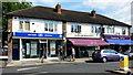 TQ1369 : Row of shops, Hampton by Jonathan Billinger