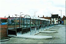 TF0920 : Covered waiting at the bus station in Bourne, Lincolnshire by Rex Needle